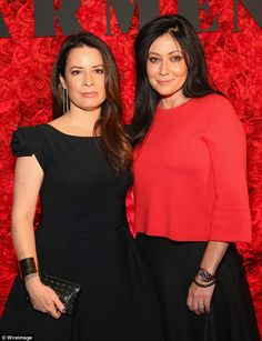 A decade on: Holly Marie Combs, 42, and Shannen Doherty, 45, who starred together on Charmed in the late 90s, look as though they have barely aged a day