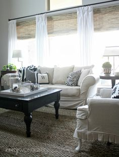 white curtains, bamboo shades, white couvhes, natural rug, love this combination of colors and decor