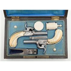 Pair of percussion marked pistols circa 1850s to 1860s with original ivory grips and accessories.