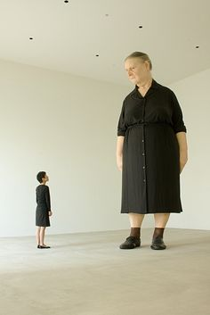 This looks like a Ron Mueck sculpture (on the right). I think the figure on the left is a living person