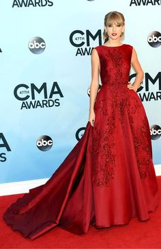 Taylor Swift.  The country star turned heads at the CMA Awards in a brilliant beaded red gown by Elie Saab
