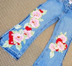 Embellish Jeans  http://patches.typepad.com/notes_from_the_patch/2010/02/tutorial-tuesday-14-fancy-pants.html