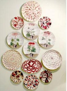 Pretty plate display...The rose color in all of the plates ties the whole display together! And the invisible hangers make it look like they are floating on the wall.