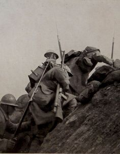 WWI, 1916, France. French soldiers going over the top.