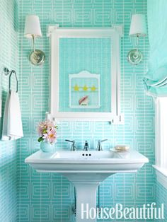 Very cheery bathroom! :) I like the light sconces on both sides of the mirror.  Collecting ideas for the 2 bathroom renos.
