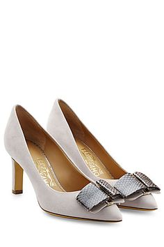 The pale grey suede of these Salvatore Ferragamo pumps is brought up-to-date with a snakeskin-effect bow at each toe. A slick, modern style, make them an impressive choice in your business wardrobe #Stylebop