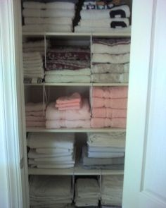 Using shelf dividers to organize towels would work great for a closet with small space.