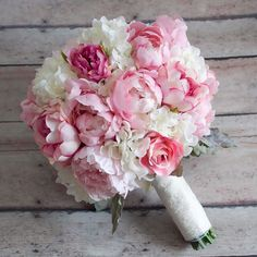 Swoon! Varying shades of pink peonies and roses accented with hydrangeas lamb's ear and lace. Yes please! By @katesaidyesweddings, www.katesaidyesweddings.com