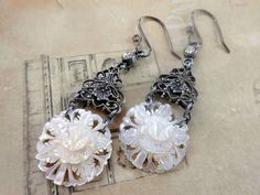 Carved mother of pearl assemblage earrings have a great antique Victorian style to them. The mother of pearl portion were vintage clip back earrings