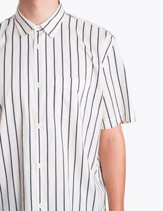 """Shirt from <a href=""""http://tres-bien.com/our-legacy/"""" class=""""uniquelink"""">Our Legacy</a>. Boxy fit. Spread collar. Front button closure. A single patch pocket on the chest. Back yoke and box pleat. Short sleeves. Curved hem."""