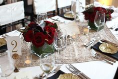 Romantic Red Wedding, Calhoun Beach Club, Minneapolis, MN - Linen Effects - www.lineneffects.com - Minnesota Party Rental Decor - Photography by Studio 306 -- beaded champagne overlay on this wedding reception guest table with gold plates, black napkins, and burgundy floral. -- #Calhoun #beach #club