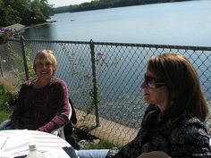 Jan and Terri relax during a workshop exercise by the lake during our retreat. Have you guessed yet where it was? Hint: Dillman's Bay.