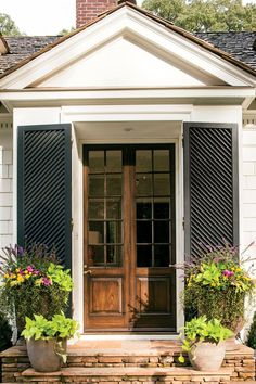 Adding shutters - a little different than the norm - to this entry makes an inviting entry