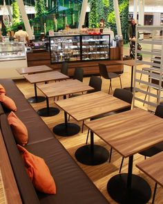 ENEA's #Lottus chairs and stools in the cafeteria Choco Mania of Malmo, Sweden. Both the chairs and stools, designed by Lievore Altherr Molina, in dark brown polypropylene.