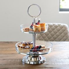 High tea, high wine or maybe even a high beer. Whatever you decide, there is space for all the tasty snacks on this stylish glass display stand. Only the platters are of glass, because the sturdy leg and the base connecting the two layers of the display s Side Table Decor, Table Decorations, High Tea, Home Interior, Yummy Snacks, Serving Bowls, Decorative Bowls, Layers, Tasty