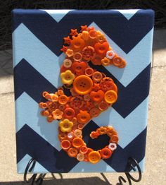 A Cute range Button Seahorse  great of hanging in kids room. Giving the room a burst of color and inspiring a wild imagination for beautiful dreams right before bed. This Canvas stands 8x10 and is prices at $25 in OliveCrafting Esty Shop.