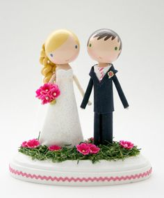 So Cute! custom wedding cake topper. $150.00, via Etsy.