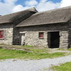 The Famine Cottages Dingle located along the wild Atlantic way in Co. Cottages, Cabin, Pets, House Styles, Building, Travel, Construction, Voyage, Trips