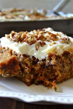 This truly is the BEST EVER Carrot Cake Moist fluffy tender spiced cake filled with juicy pineapple crunchy pecans fresh carrots and aromatic spices topped with an orange-spiked cream cheese icing So perfect a total crowd-pleasing impressive cake Brownie Desserts, Mini Desserts, Just Desserts, Delicious Desserts, Dessert Recipes, Yummy Food, Frosting Recipes, Coconut Dessert, Oreo Dessert