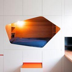 어린이를 위한 아지트, 캐비넷 침대. Belgium-based Van Staeyen Interieur Architecten designed a wall of cabinets with a sleeping nook for a child's bedroom. Design: Van Staeyen Interieur Architecten Photography by Luc Roymans from contemporist