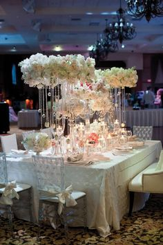 White-on-white dramatic arrangements decorated with crystal beading