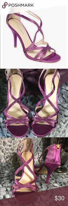 """Nine West Altemis purple satin sandal heels sz 6 Gorgeous Nine West Satin Sandel heel in a beautiful shade of purple. The straps are covered with purple rhinestones reflecting a stunning sparkle. Perfect for cocktail attire or wedding. Brand new With price tag on the shoe sole ***Size 6**** Shoe detail: back zipper closure, purple rhinestones throughout straps and back closure, purple satin with 4"""" heel. Nine West Shoes Heels"""