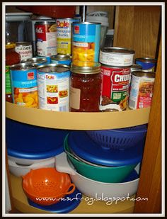 Idea for how to use the lazy susan corner cabinet in your kitchen - store your canned goods there {featured on Home Storage Solutions 101}