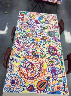 Gorgeous collaborative art project made from circles and lines.  Each student starts at their table and paints a circle then moves to another table to add on to someone else's circle and more.