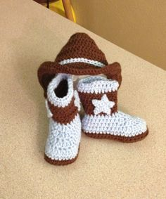 Crochet baby boots and cowboy hat.