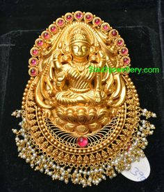 22 carat gold Goddess Lakshmi pendant studded with rubies and hanging basara pearls clusters at the bottom. Jewelry Design Earrings, Gold Earrings Designs, Pendant Jewelry, Jewlery, Gold Temple Jewellery, 18k Gold Jewelry, Ruby Jewelry, Antique Jewellery, Indian Jewellery Design