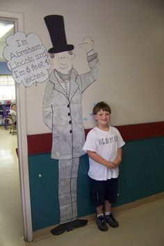 Are you taller than Abraham Lincoln? Sticky notes on the wall mark how tall each student was compared to Abraham Lincoln.