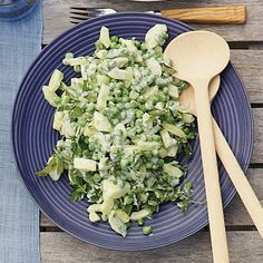 Cucumber and Baby Pea Salad | This green salad contains no lettuce and no vinaigrette—just cucumbers, peas, parsley and basil in a tangy yogurt dressing.