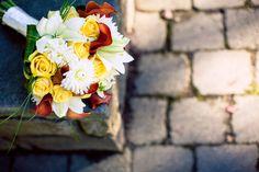 Such a #beautiful #white, #yellow + #red #bouquet. ::Lorena + Matthew's vibrant catholic wedding in Hillsboro, Oregon:: #stones #outdoorphotography #bridalbouquet #lilies #roses #daisies #dahlias #septemberwedding #floral #floralarrangement #weddingdetails #weddingflowers #flowers #weddingphotography