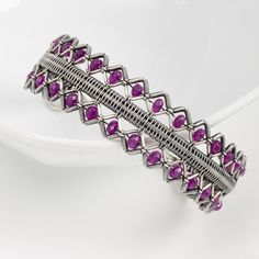 Learn how to make a lattice bracelet with just wire. Instructions include how to do the modified soumak weave, which is used to bring the wires together. With 43 colored step out pictures every detail is photographed with accompanying text.