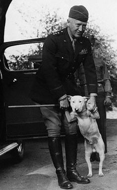 US Lt General George S Patton playing with his bullterrier Willy