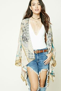 A woven kimono featuring an allover paisley print, open-front, high-low hem, and long dolman sleeves.