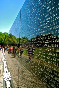 Vietnam Veterans Memorial (USA). The opposite of DC's white, gleaming marble, the black, low-lying Vietnam memorial cuts into the earth, just as the Vietnam War cut into the national psyche. The monument shows the names of the war's 58,267 fatalities – listed in the order they died – along a dark, reflective wall.