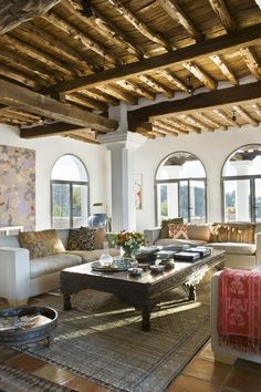 rustic, wood beams, carved coffee table arch top windows