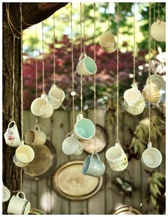 Tea cup theme, cool because its resusuing recycled goods hanging cups if sturdy enough could be transformed into shelves for products using bigger bowls for bigger products, can also be a display in its self