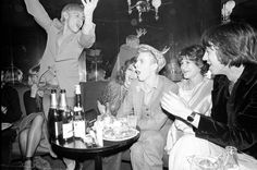 Bowie celebrates his birthday and the end of the Isolar tour at L'ange Bleu in Paris with (from left to right) Iggy Pop, Romy Haag, Coco Schwab, and Pat Gibbons.
