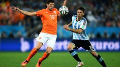 2014 FIFA World Cup™ - Photos - FIFA.com  Klaas-Jan Huntelaar of the Netherlands and Martin Demichelis of Argentina compete for the ball