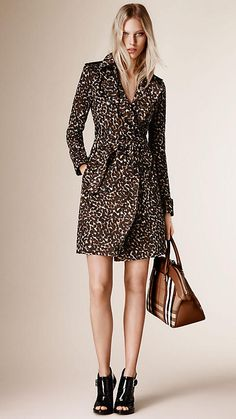 Burberry Camel Animal Print Cotton Trench Coat - A cotton trench coat with an all-over animal print design. A Kensington modern fit, the trench coat is tailored to the body with slim set-in sleeves. An undercollar in cotton gabardine and heritage-inspired epaulettes and cuff belts complete the design.