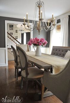 Mixing and matching the seating at a dining room table helps keep the room from seeming too formal. We love how this tufted bench from @homegoods offsets the other chairs. (sponsored pin)