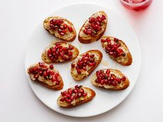Get White Bean-Pomegranate Crostini Recipe from Food Network