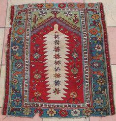 "Antique Turkish Prayer rug 19th century 132 x 111 cm. Dramatic ""white feather"" motif in centre."