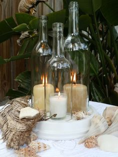 candles in reused wine bottles. Cut off bottom with tutorial.