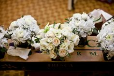 White and grey bouquets by Eden's Echo.
