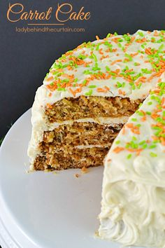 This Super Moist Carrot Cake Recipe has everything you know to be in a carrot cake.  Full of freshly grated carrots, pineapple, coconut, pecans and for ext