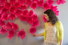 DIY Flower Photobooth Backdrop | Lovely Indeed Not entirely sure when I'll be needing a photo backdrop, but this just looks so cute! Or even your own photoshoot with the little ones :) #flowers #photos