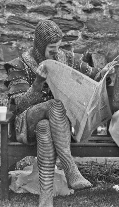 The actor John Cleese is taking a break on the set of the film Monty Python and the Holy Grail. It is a British surreal comedy film written and performed by the comedy group of Monty Python (Graham. Monty Python, Saturday Night Live, Elvis Y Priscilla, Journal Photo, People Reading, Photos Rares, Aziz Ansari, Yvonne Craig, Rick James